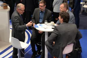 Exhibitor talking with clients or potential clients on the SOLUTRANS exhibition.